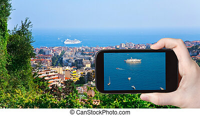 tourist taking photo of ships near Cannes - travel concept -...