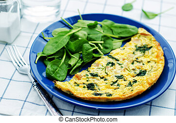 Frittata with chicken and spinach and fresh spinach on a...