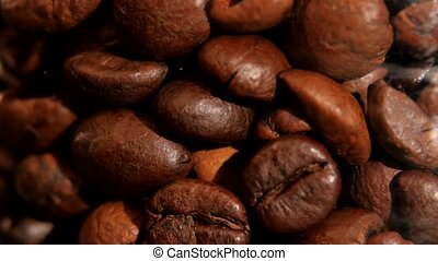 Lot of roasted coffee beans, rotation - A lot of roasted,...