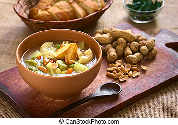 Bolivian Sopa de Mani (Peanut Soup) - Bowl of traditional...