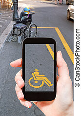 taking photo of parking space for disabled people