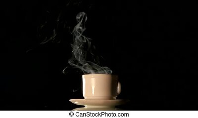 Steaming white coffee cup on black background - Freshly...