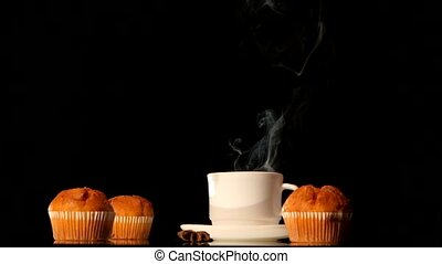 Steaming white coffee cup with cakes, anise, cinnamon on...