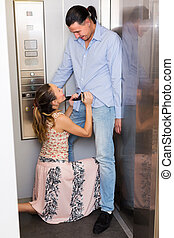 Couple having foreplay in lift - Handsome man and girl...
