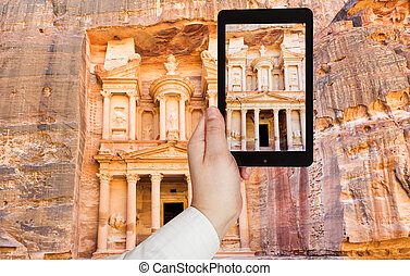tourist taking photo of Treasury Monument in Petra