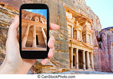 taking photo of Treasury temple in rock of Petra