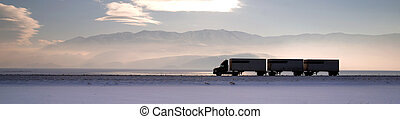Semi Truck Travels Highway Over Salt Flats Frieght Transport...
