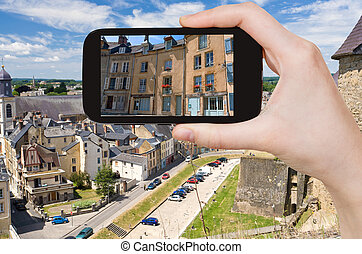 tourist taking photo of Sedan town, France - travel concept...