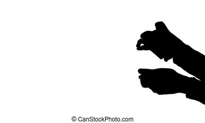 Magician showing his trick on white background, silhouette -...