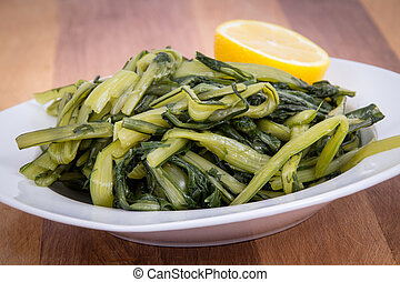Prepared boiled dandelion greens bowl