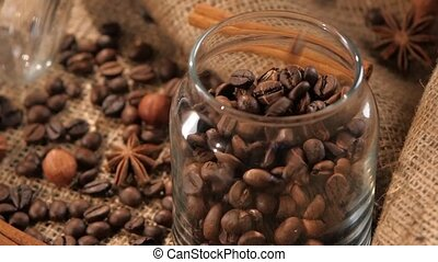 Pouring coffee beans into a bottle on background with...