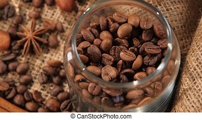 Top of pouring coffee beans into a bottle on background with...