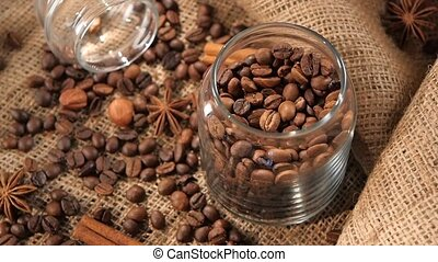 Top of bottle with coffee beans on background, hazelnut,...