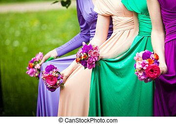 Friends of the bride - Bridesmaids in colorful dresses with...