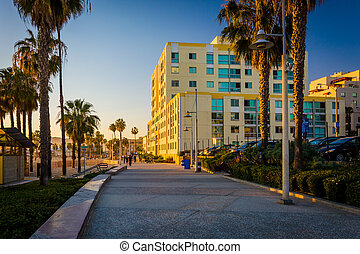 Evening light on the Oceanfront Walk, in Santa Monica,...