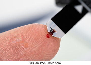 Person Finger With A Glucometer - Close-up Of Person Finger...