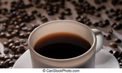 Cup of coffee with splashes from sugar, slow motion - White...