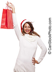 Happy vivacious Christmas shopper wearing a red Santa hat...