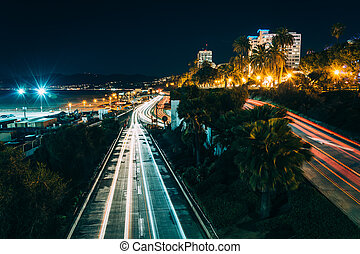 Traffic on Pacific Coast Highway at night, in Santa Monica,...
