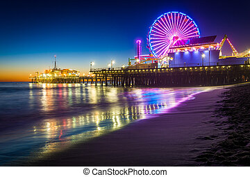 The Santa Monica Pier at night, in Santa Monica, California.