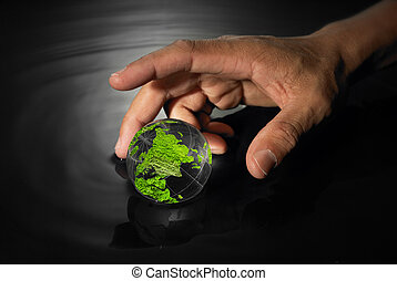 Hand reaching for crystal earth ball