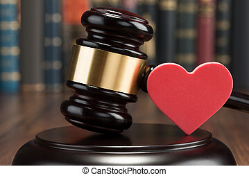 Gavel And Red Heart On Table - Close-up Of Wooden Gavel And...