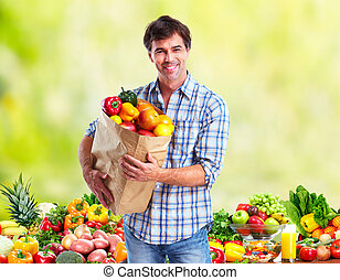 People with Vegetables over green background Healthy diet