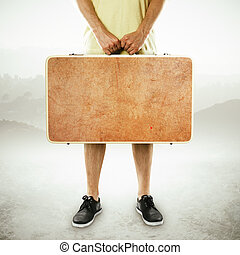 man holding suitcase on a white background