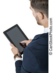 Businessman using a tablet computer navigating the...