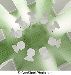 Circle of white chairs in green