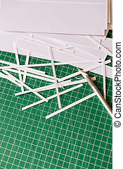 Cropping tools - Scalpel and cutting mat and scraps of paper