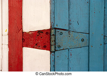 Door hinge - Close up shot of a Blue, white and red door...