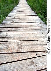 Old elevated rural boardwalk - Old elevated wooden boardwalk...