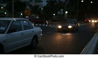 night city traffic with switched headlights - night city...
