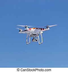 quadrocopter - red-white quadrocopter with a video camera on...