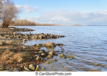 Dnieper River - A sunny day with white clouds at the end of...