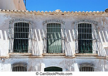 Old Spanish house. - Old house with wrought iron grills...