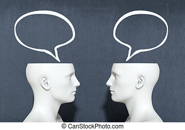 concept of dialogue - two heads with speech bubbles, concept...
