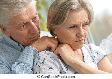 Sad elder couple  - Portrait of a sad elder couple at home