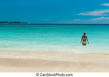 Tropical beach - Woman at serene tropical beach of Gili...