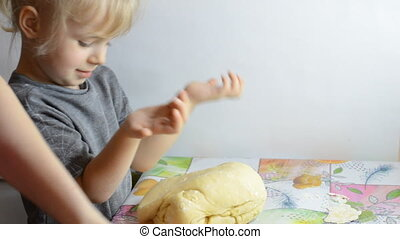 Funny Little Girl Flattening the Dough and Cooking Dumplings...