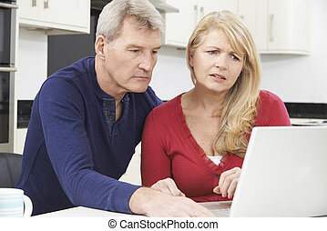Worried Mature Couple Reviewing Domestic Finances