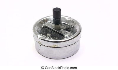 Metallic Ashtray - Hand with cigarette using a grungy...