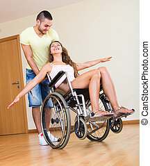 young educator and handicapped - caregiver and woman in...