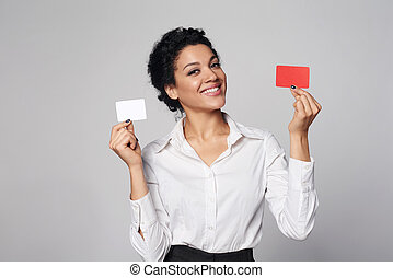 Business woman showing blank credit card - Happy african...