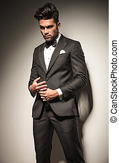elegant young business man playing with his ring. - Side...