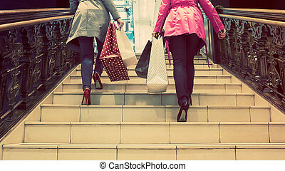 Two unrecognisable young female friends enjoying a day out...