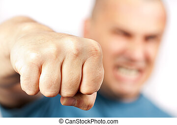 Aggressive man punching - Strong built aggressive man...