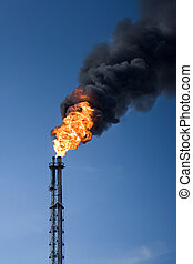 Global warming - Refinery funnel burning with huge flame and...