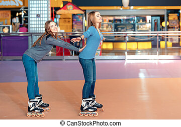 Beautiful girls on the rollerdrome - Grace on skates. Two...